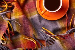 Top view of mug of hot drink on coloured coverlet with copy space for your text or advertisment. The moment of relaxing holiday in Stock Photography