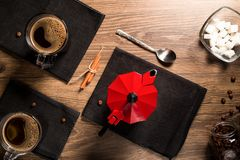 Top view on mugs of coffee on black napkins near the red coffee Stock Photo