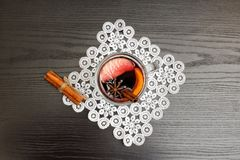 Top view on mulled wine with spices. Black wood background.  Royalty Free Stock Photography