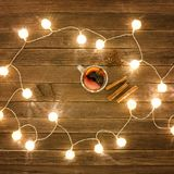Top view of mulled wine with spices, cinnamon sticks, star anise. Wooden table. Lanterns Royalty Free Stock Photos