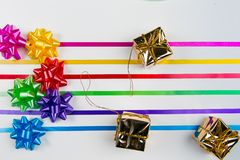 A top view of multi-color gift wrap bows with matching ribbons stock image