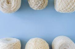 Top view of multi-colored woolen balls of yarn in a row stock photography