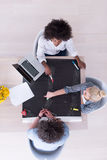 Top view of Multiethnic startup business team on meeting Royalty Free Stock Photography
