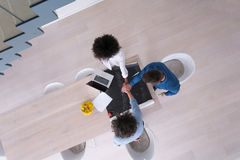 Top view of Multiethnic startup business team on meeting Royalty Free Stock Image