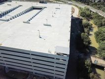 Top view multistory garage parking space under construction in Texas, USA. Aerial view multistory garage under construction. Multilevel parking space for royalty free stock photography