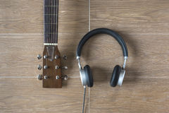 Top View of Musician Stuffs on Table. Guitar and Headphone on Wo Royalty Free Stock Images