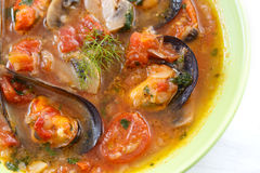 Top view of mussels soup with vegetables Stock Image