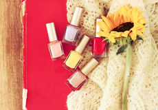 Top view of nail polish bottles over wooden table. filtered image Royalty Free Stock Photos