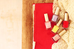 Top view of nail polish bottles over wooden table. filtered image. Royalty Free Stock Photos