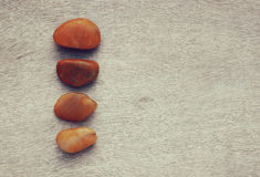 Top view of natural stones on old wooden table. filtered image . room for text Stock Photos