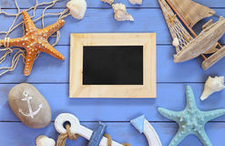 Top view of nautical concept with blank chalkboard next to nautical life style objects stock photography
