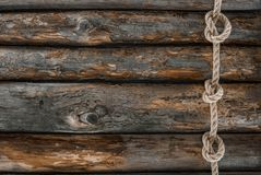 Top view of nautical rope with knots on grunge. Wooden surface royalty free stock image