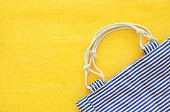 Top view of nautical summer/beach bag on yellow wooden background Stock Photography