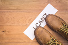 Top view new men shoes step on word I CAN'T in white crumpled Royalty Free Stock Photo