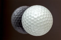 Top view the new white golf ball with the reflection, sport concept. royalty free stock photos