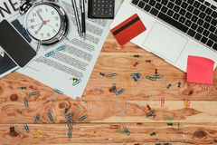 Top view of newspaper, laptop, credit card, smartphone and office supplies. On table Stock Photography
