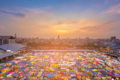 Top view night multiple colour weekend market. With sunset and downtown background Stock Photography