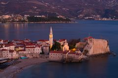 Top view of night old city Budva with beautiful backlighting stock image