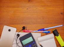 Top view notebook,calculator and stationery on brown wooden table. Business,education concept royalty free stock images