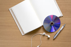 top view of notebook earphone and dvd dish Stock Image