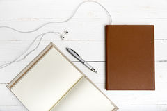 top view of notebook and earphone Stock Photo