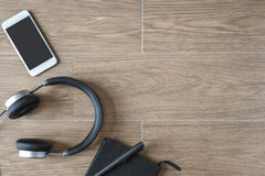 Top View of Notebook, Mobile Phone and Headphone Stock Photography