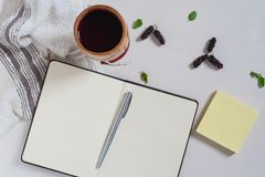Top view of notebook, paper note, mulberry juice. Top view of notebook, yellow paper note, mulberry juice on white wooden table royalty free stock photography