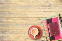 Top view of notebook,passport,pencil and cup of coffee on office. Desk background.Home office for workspace with business accessories on table Stock Photography