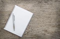 Top view of notebook and pen Stock Photos