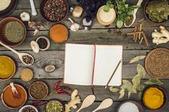Notebook for recipes. Top view of notebook for recipes with spices on a table Royalty Free Stock Photo