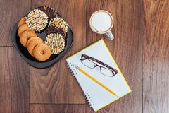Top view of notebook, stationery, drawing tools and a few cups coffee. Royalty Free Stock Photography
