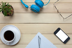 Top view notepaper,headphones,smartphone,pen,coffee ,cactus,eyeg Royalty Free Stock Photography