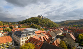 A top view o Wernigerode with a medievel castle. A top view over Wernigerode town with a medievel castle crowning the hill top. Wide angle picture taken from the Royalty Free Stock Images
