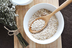Top view of oat in wooden spoon Stock Photo
