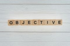 top view of objective word made of blocks on white royalty free stock image