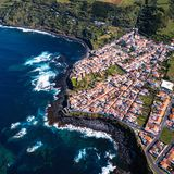 Top view the ocean surf on reefs coast in Maia city of San Miguel island, Azores. Portugal royalty free stock photo