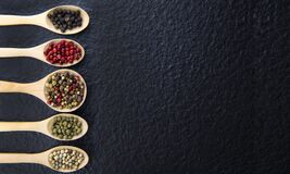 Free Top View Of 5 Types Of Peppercorn In A Wooden Spoon On A Black Background Healthy Food Concept Stock Photography - 184195222