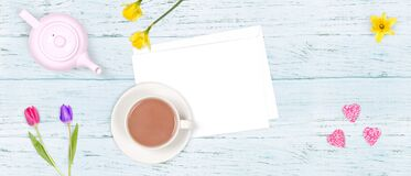 Free Top View Of A Romantic Scene Of A Cup Of Tea, A Tea Pot, Flowers And An Envelop On A Wooden Background. Background, Banner Or Royalty Free Stock Image - 197836706