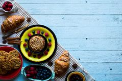 Free Top View Of A Wood Table Full Of Cakes, Fruits, Coffee, Biscuits Stock Photo - 109785780