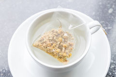 Top View Of Aroma Chamomile Tea Bag Floating On White Teacup, Re Royalty Free Stock Photography