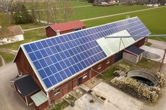 Free Top View Of Blue Solar Photo Voltaic Panels System On Wooden Building, Barn Or House Roof. Renewable Ecological Green Energy Stock Image - 153629111