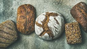 Top View Of Bread Loaves Over Grey Concrete Background Royalty Free Stock Photos