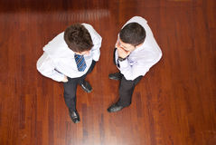 Top View Of Business Men Telling Secret Stock Photo