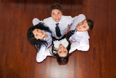 Top View Of Business People In A Huddle Stock Images