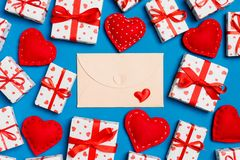 Free Top View Of Colorful Valentine Background Made Of Craft Envelope, Gift Boxes And Red Textile Hearts. Valentine`s Day Concept Stock Image - 168515891
