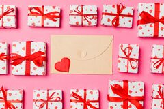 Free Top View Of Colorful Valentine Background Made Of Craft Envelope, Gift Boxes And Red Textile Hearts. Valentine`s Day Concept Royalty Free Stock Photo - 168795925