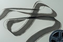 Free Top View Of Film Reel With Twisted Cinema Tape Royalty Free Stock Photo - 155837535