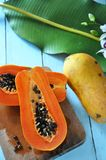 Top View Of Half Papaya On Wooden Board Stock Photo