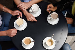 Top View Of Hands With Coffee Cups In A Urban Cafe. Stock Photos