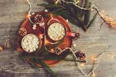 Free Top View Of Hot Cocoa With Marshmallows On Rustic Wooden Table With Christmas Lights Stock Photos - 101470353